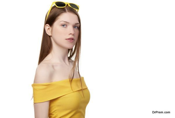 Redheaded female in yellow top and sunglasses