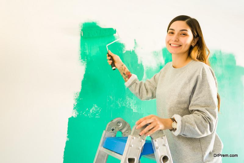 woman painting walls